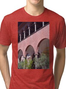 Building with red brick facade and arches in Siena. Tri-blend T-Shirt