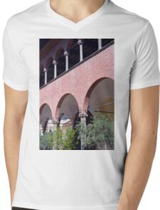 Building with red brick facade and arches in Siena. Mens V-Neck T-Shirt
