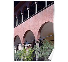 Building with red brick facade and arches in Siena. Poster