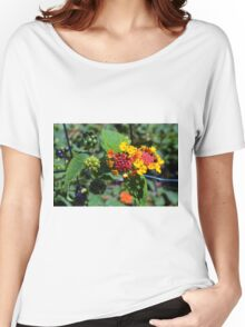 Natural background with colorful flowers and green leaves. Women's Relaxed Fit T-Shirt