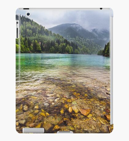 Lake in mountains, in a rainy day iPad Case/Skin