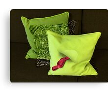 Water Pillow Sandwiched between Lime Green Pillows and Red Hose Ribbon Canvas Print