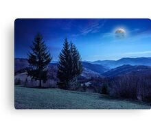 autumn hillside with red and yellow forest at night Canvas Print