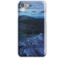 light on stone mountain slope with forest at night iPhone Case/Skin