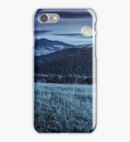 valley in mountains  on hillside under sky with clouds at night iPhone Case/Skin