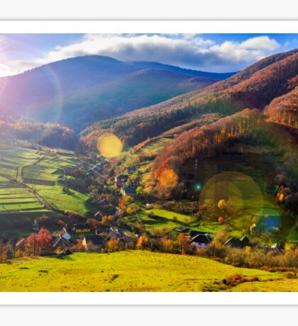 light  beam falls on hillside with autumn forest in mountain Sticker
