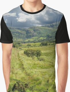 fence leading to trees and rocky mountains  Graphic T-Shirt