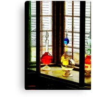 Colorful Bottles in Drug Store Window Canvas Print