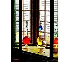 Colorful Bottles in Drug Store Window Photographic Print