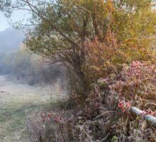 wooden fence in fog on frozen meadow at sunrise Sticker