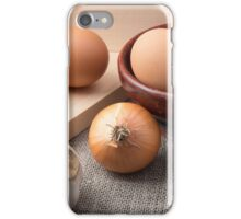 Raw eggs, onions and garlic on a background of burlap iPhone Case/Skin