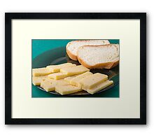 Pieces of yellow hard dry cheese and white bread slices Framed Print