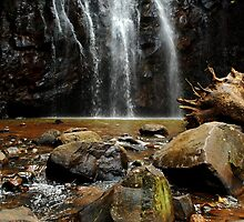water fall over rocks and stones by Mark Malinowski