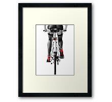 Sexy woman in red high heel shoes and stockings riding bicycle art photo print Framed Print