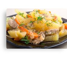 Dish of stewed potatoes with chicken and spices Canvas Print