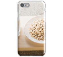 Glass of milk and a plate of cereal closeup iPhone Case/Skin