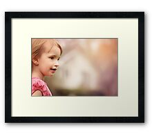 Portrait of a blonde girl with green eyes Framed Print