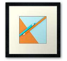 Orange and Turquoise coloured pencils and paper Framed Print