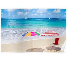 Beach umbrellas and chair by the ocean Poster