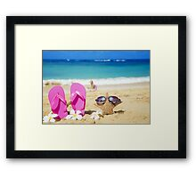 Flip flops and starfish with sunglasses on sandy beach Framed Print