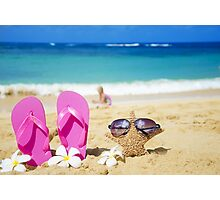 Flip flops and starfish with sunglasses on sandy beach Photographic Print
