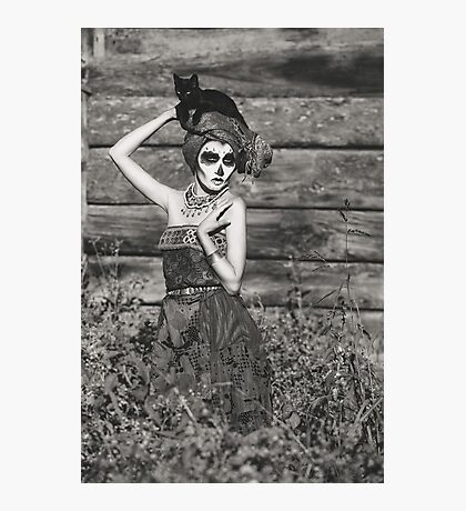 Santa Muerte halloween costume. Witch woman and black cat witch death make-up. Photographic Print