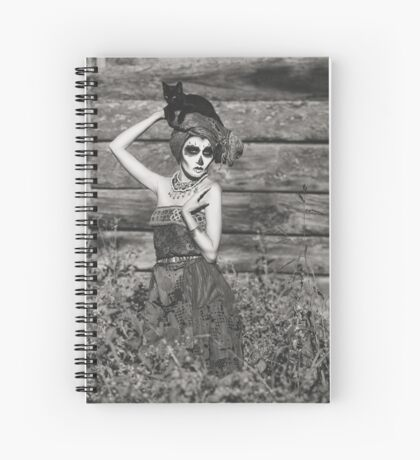 Santa Muerte halloween costume. Witch woman and black cat witch death make-up. Spiral Notebook