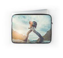 Traveler hipster man walking in front of beautiful mountain landscape. Laptop Sleeve