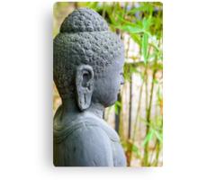statue of buddha in zen garden Canvas Print
