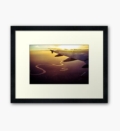 Snake river under plane wing at sunset Framed Print