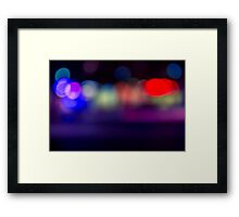 abstract blur of red, blue and purple lighting night club disco dance floor Framed Print