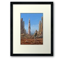 Old Saturn V rocket in desert Framed Print