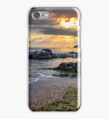morning sun rays illuminate sandy beach with small rocks iPhone Case/Skin