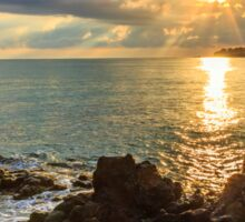 Menacing morning sea landscape with rocky coast and rising sun rays Sticker