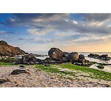 rocks and seaweed on sand coast of the sea Photographic Print