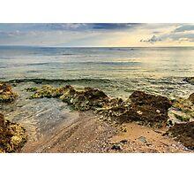 wave rolls onto the rocks of sandy beach Photographic Print