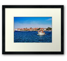 small pleasure boat out to sea Framed Print