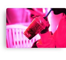 Surreal image of young woman drinking ice drink with straw Canvas Print