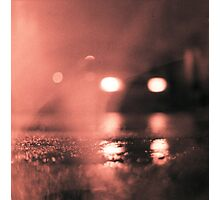 Analog photo of tarmac of street at night with car headlights in rain Photographic Print