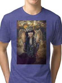 woman sitting outdoor in autumn scenery Tri-blend T-Shirt