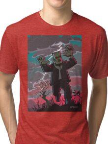 frankenstein creature in storm  Tri-blend T-Shirt