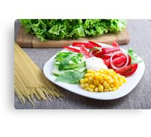 Healthy vegetarian dish of fresh vegetables on a gray textured fabric Canvas Print