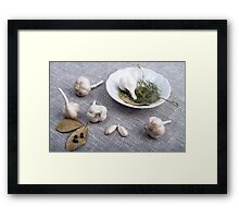 Garlic and spices on a gray fabric background Framed Print
