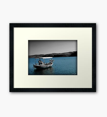 Boat and Blue Sea Framed Print