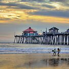 Young Surfers At Huntington Beach Pier by K D Graves Photography