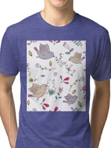Cute little birds in flight with bright colourful flowers and leaves, a fun pretty repeating illustration on white, classic statement fashion clothing, soft furnishings and home decor  Tri-blend T-Shirt
