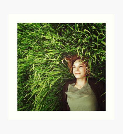 Beautiful young woman lying in the grass Art Print