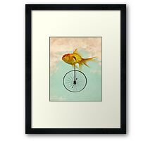 unicycle goldfish Framed Print