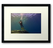 An Underwater Photographer Hovers Framed Print