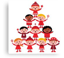 Happy multicultural kids in red winter costumes. Great design for christmas party. Canvas Print